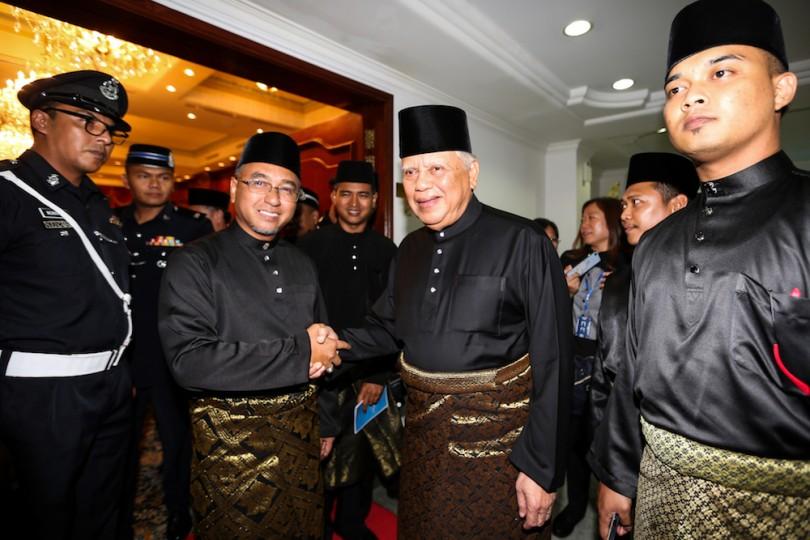 Newly appointed Melaka Chief Minister Adly Zahari shakes hand with Yang Di-Pertua Negeri Melaka