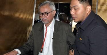 Datuk Azmi Nordin (left)