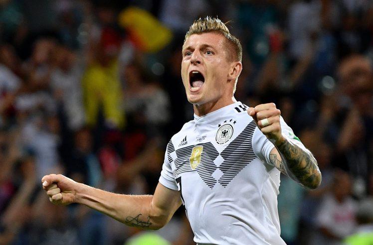 Toni Kroos celebrates after scoring the winning goal against Sweden.