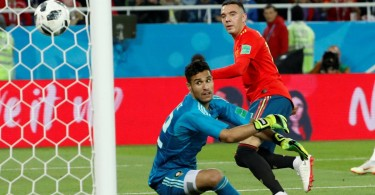 Spain's Iago Aspas scores their 92nd-minute equalising goal to salvage a point against Morocco and mean they topped Group B and will face Russia in the last 16.