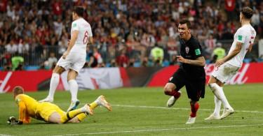 Mandzukic (in navy blue) reacts after scoring Croatia's winning goal.