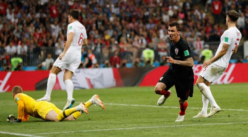 Mandzukic (in navy blue) reacts after scoring Croatia's winning goal.