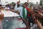 Supporters lined the roads leading to the rallies where Imran Khan spoke, swarming his entourage to fling rose petals.
