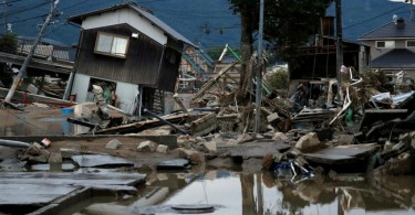 Submerged and destroyed houses are seen in a flooded area in the Mabi district of Kurashiki, Okayama Prefecture,