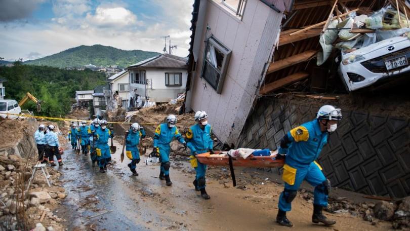 Japan flood toll nears 200, sun scorches thousands ...