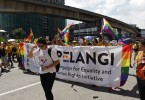 LGBT rights supporters join Bersih 5 rally holding a banner by the Pelangi Campaign for Equality and Human Rights Initiative in Kuala Lumpur on November 19, 2016.