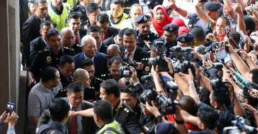 Press photographers jostled for pictures of  Datuk Seri Najib Razak upon his arrival at the court.