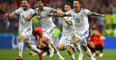 Russian players celebrate after defeating Spain.
