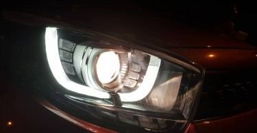 projector halogen headlight with U-shaped LED daytime running lights and LED indicators
