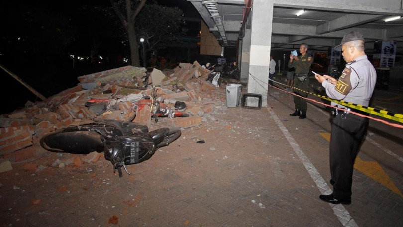 Police/security personnel checking the damage.
