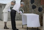 Japanese Emperor Akihito and Empress Michiko offer flower bouquets at a memorial as they offer prayers for war victims at Peleliu island in Palau in August 2015.