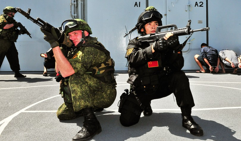 Chinese and Russian marines pose during Joint Sea 2015 exercise in the Mediterranean on May 20, 2015.