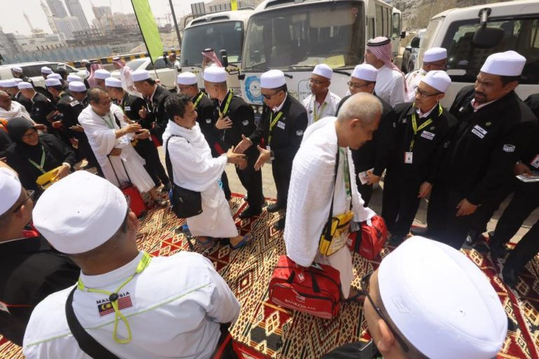 Pilgrims being greeted by Tabung Haji personnel upon their arrival in Mecca.