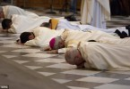 Archbishop of Granada Francisco Javier Martinez and priests prostrate themselves in front of the altar to seek pardon for sexual abuse in the Church at the cathedral in Granada, southern Spain in January 2015.