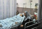 A teenage Palestinian patient lies on a bed in Makassed Hospital in East Jerusalem.