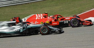 Ferrari driver Kimi Raikkonen, passes Mercedes AMG Petronas driver Lewis Hamilton to win the United States Grand prix yesterday.