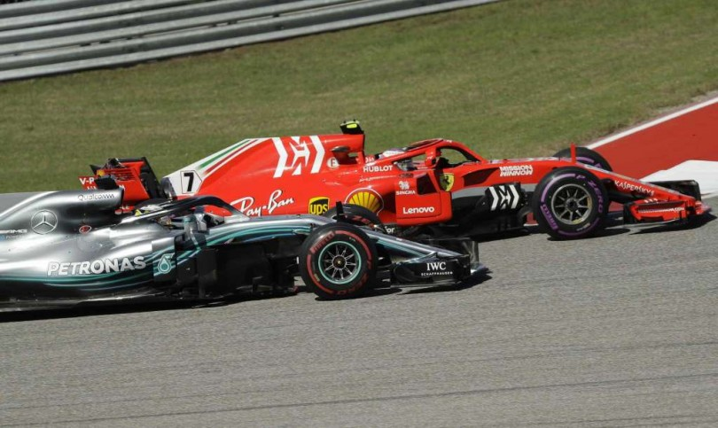 Ferrari driver Kimi Raikkonen, passes Mercedes AMG Petronas driver Lewis Hamilton to win the United States Grand prix yesterday.