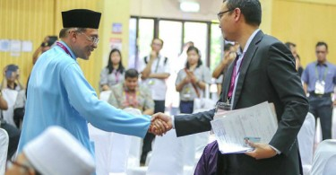Anwar Ibrahim and his former aide turns contender Saiful Bukhari Azlan on nomination day of the Port Dickson by-election. Saiful's sodomy accusations against Anwar led to a second jail term for the prime minister-in-waiting.