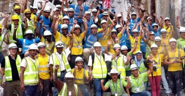 MMC-Gamuda workers celebrating after the variable density tunnel boring machine broke through into the Pasar Rakyat station box in Kuala Lumpur in Nov 2015. Over 20,000 of such workers are at risk of losing their jobs if the company's MRT2 contract is terminated.