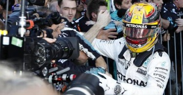 Mercedes AMG Petronas driver Lewis Hamilton celebrates with his team after winning the Japanese Formula One Grand Prix at Suzuka yesterday.