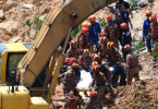 Rescuers carrying the body of  a victim in the latest tragic landslide incident in Penang.