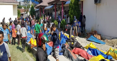 Bodies of earthquake victims  in Sulawesi Indonesia were placed on the road as rescuers search for more.