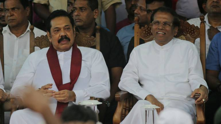 Rajapaksa (left) with Sirisena.