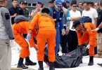 Rescue workers of crashed Lion Air flight JT610 carry a body bag off a boat at Tanjung Priok port in Jakarta