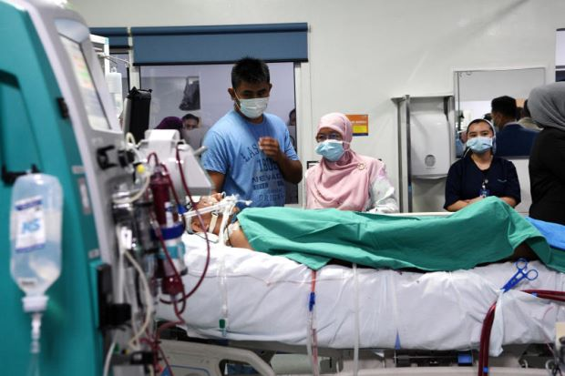 Muhammad Adib Mohd Kassim receiving treatment at the National Heart Institute (IJN).
