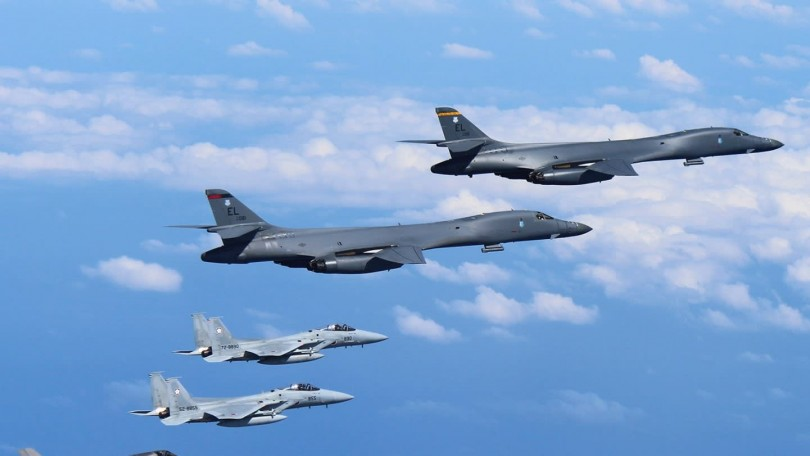 US B-1 bombers fly with Japanese F-15 fighters in a joint exercise.
