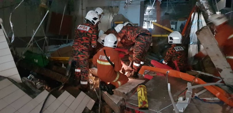 Rescuers at the site of explosion