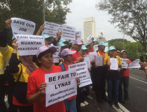 Lynas employees at the entrance of the Parliament building today.
