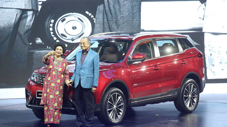 Prime Minister Tun Dr Mahathir Mohamad and Tun Dr. Siti Hasmah  at the launching of Proton X70 last night.