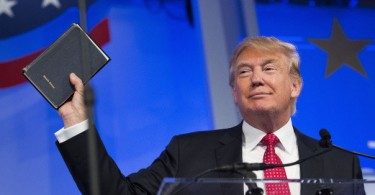 US president Donald Trump,  holds up a Bible while speaking at the Values Voter Summit in Washington Sept. 25, 2015.