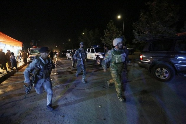 Afghan security personnel reacting to the Taliban attack which killed over 100 people yesterday.