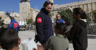 Members of Temporary International Presence in Hebron (TIPH) engaging Palestinian children during their monitoring rounds of the city.