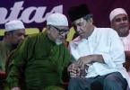 Pas president Datuk Seri Abdul Hadi Awang and  Umno deputy president Datuk Seri Mohammad Hassan