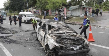 The car that was set ablaze during the Sri Maha Mariamman riot.