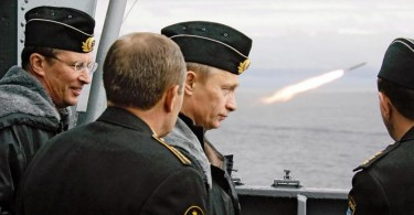 Russian President Vladimir Putin (2nd R) and Russian Defence Minister Sergey Ivanov (L) watch the launch of a missile during military exercises in the Barents Sea in 2005.