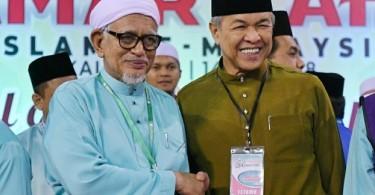 Datuk Seri Abdul Hadi Awang (left) and Datuk Seri  Ahmad Zahid Hamidi at Pas general assembly in Kuala Terengganu on Sept 15 2018.