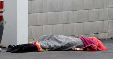 A body lies on the footpath outside a mosque after the shooting incidents in Christchurch, New Zealand
