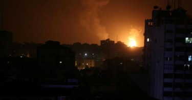 Smoke and flames are seen during the Israeli air strike on Gaza.