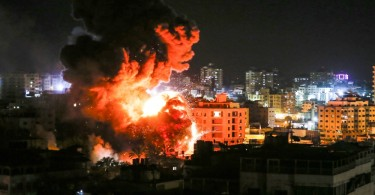 Flames and smoke are seen during an Israeli air raid in Gaza City.