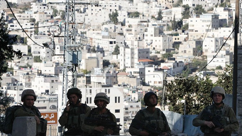 Israeli soldiers stand guard blocking an entrance to the Jewish settlers zone of Hebron's Tel Rumeida neighbourhood.