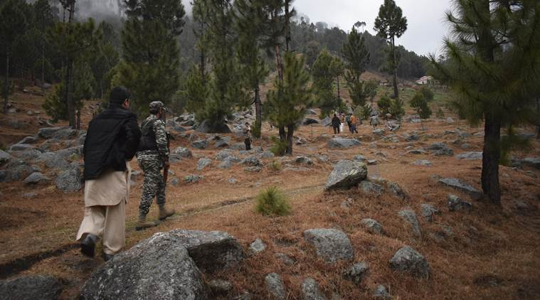 Pakistani reporters and soldiers checking the area near the targetted madrasa near Balakot, Khyber Pakhtunkhwa province, Pakistan.