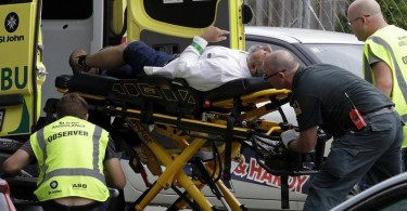 A injured victim of the shooting at a mosque in Christchurch being taken to hospital in an ambulance.