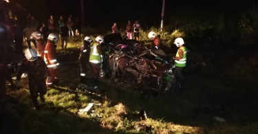 Rescuers at the scene of the fatal crash in Raub.