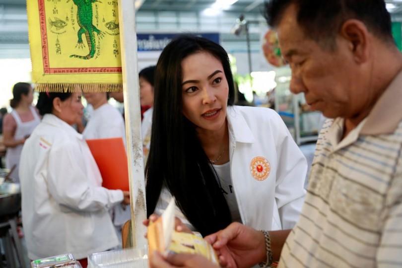 Sirima Sarakul, 36, a candidate for the Pandin Dharma Party talks to supporters during their campaign rally in Bangkok.