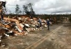 Residents of Lee County , Alabama inspecting the damage caused by the tornado.