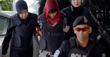 Doan Thi Huong being escorted at the court today.